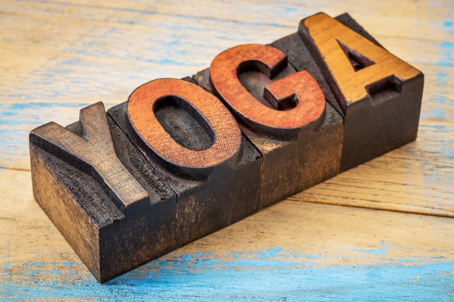 yoga word - text in vintage wood letterpress type blocks stained by color inks